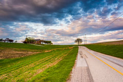 Country road and church on top of a hill in rural York County, P Stock Photography