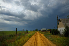 Country Road. With cloudy sky storm moving in on a nice day Stock Images