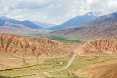 Country road in colorful Tien Shan mountains Stock Photo