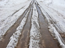 Road with melting snow Royalty Free Stock Photo