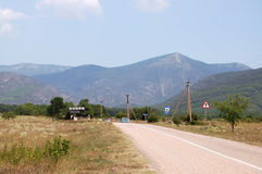 Country road in Crimea. At sunny summer midday Royalty Free Stock Photo