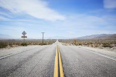 Country Road Through Desert Looking Towards Horizon royalty free stock images
