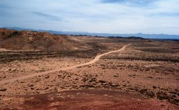 Country road in deserts Royalty Free Stock Images