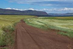 Country road disappearing into the distance. Steppes Of Khakassia. Russia Royalty Free Stock Images