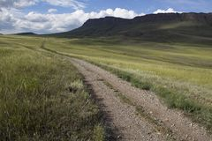 Country road disappearing into the distance. Steppes Of Khakassia. Russia Royalty Free Stock Photography