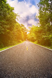 Country road between district to the city, Journey way of traveler to the nature, Road in the mountain and the forest for travel Stock Images