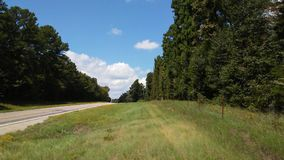 Country road. East Texas Pineville hainesville quitman blue skies fluffy clouds royalty free stock photo