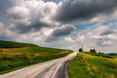Country road and farm fields in rural Southern York County, PA Royalty Free Stock Image