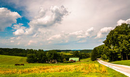Country road and farm fields in Southern York County, Pennsylvan Royalty Free Stock Photo