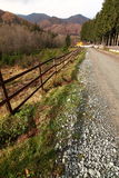 Country road and fence Stock Photo