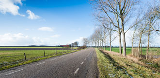 Country road in a flat rural landscape Stock Image