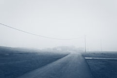 Country road with fog in the morning Royalty Free Stock Photo