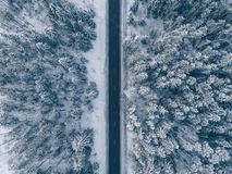 Country road going through the beautiful snow covered landscapes. Aerial view. Drone photography Stock Images