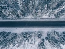 Country Road Going Through The Beautiful Snow Covered Landscapes. Aerial View. Royalty Free Stock Photography