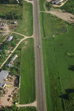 Country road and Green field aerial view Royalty Free Stock Images