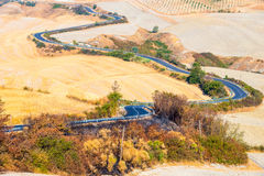 Country road and hills in Crete Senesi Tuscany Royalty Free Stock Photography