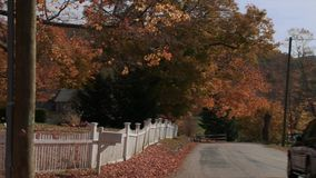 Country road with house in Autumn (3 of 3). A view or scene from around town stock video