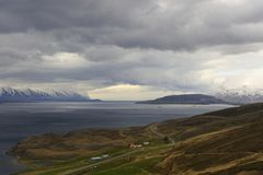 Country road. In Iceland, a road drive us where the sky is blue and the storm is over Royalty Free Stock Images