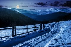 Country Road In To The Winter Mountains At Night Stock Photos