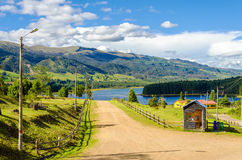 Country Road and Lake Stock Photography