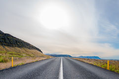 Country road leading to glaciers, Iceland Royalty Free Stock Images