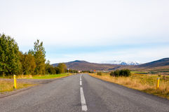 Country road leading to glaciers, Iceland Stock Images