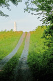 Country road leading to a mountain peak. Royalty Free Stock Photography