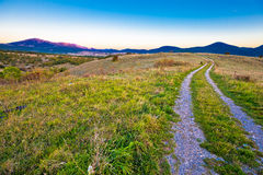 Country road in Lika region landscape. With Velebit mountain view, Croatia Stock Images