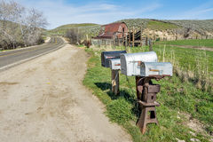 Country road with mail boxes and barn Royalty Free Stock Images
