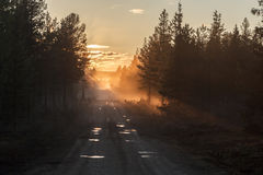 A country road in the mist Stock Photo