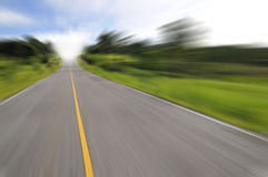 Country road with motion blur Stock Photos