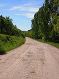 Country road. Motorbike travel in Romanian forests Stock Image