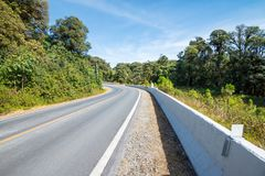 Country road on the mountain with blue sky. Country road on mountain highway with blue sky Royalty Free Stock Photography