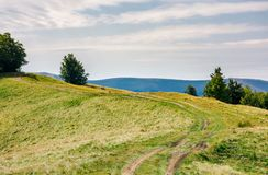 Country road through mountain ridge. Lovely countryside background royalty free stock photo