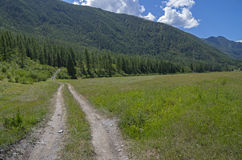Country road in a mountain valley. Stock Photo