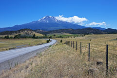 Country road with Mt. Shasta, California Royalty Free Stock Image