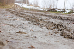 Country road with mud and snow on the side Stock Photos