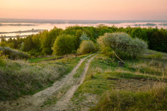 Country road near garden to the river in the morning Royalty Free Stock Photos
