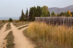 Country road near the shore of the lake. Royalty Free Stock Image