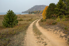 Country road near the shore of the lake. Royalty Free Stock Photography