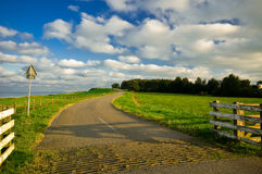 Country road in the netherland. Beautiful country road in the netherlands early in the morning Royalty Free Stock Photo