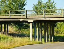 Country Road Overpass. Quiet country road with a cement overpass surrounded by grasses and trees Stock Photo