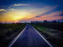 Country road with panoramic view of the sunset. Can be used with similar image no. 124943346 or 124481086 stock photo