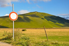 Country road with path sign of no entry Stock Images