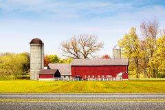 Country Road with Red Farm Stock Photography