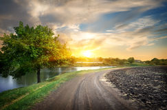 Country road and river Royalty Free Stock Photo