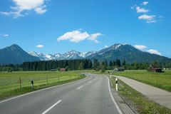 Country road from rubi to oberstdorf tourist spa town in spring stock photo