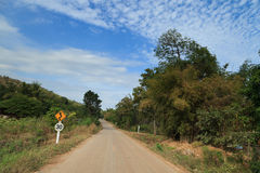 Country road in a rural area with a traffic sign Royalty Free Stock Photography