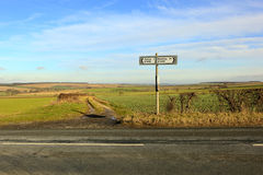 Country road sign in a sunny winter landscape Stock Photography