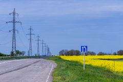 Country road. With sign and yellow fields Stock Image